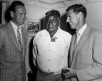 Jack Kramer (L) and Frank Sedgman (R) flank Australian aboriginal artist  Albert Namatjira